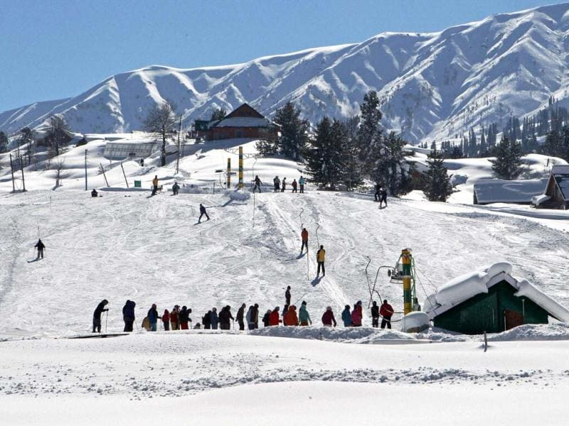Tourists ski at snow-clad Gulmarg. PTI/S Irfan