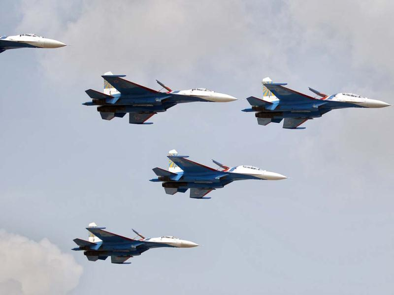 The Russian Knights, the aerobatic team of the Russian Air Force, perform in their Sukhoi Su-27 and Su-27UB fighter aircraft on the third day of the Aero India 2013 at Yelahanka air base in Bangalore. AP/Aijaz Rahi