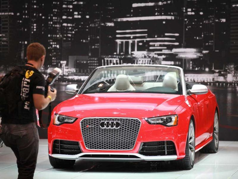 A visitor looks the Audi RS5 during the media preview at the Chicago Auto Show in Chicago. (AFP Photo)