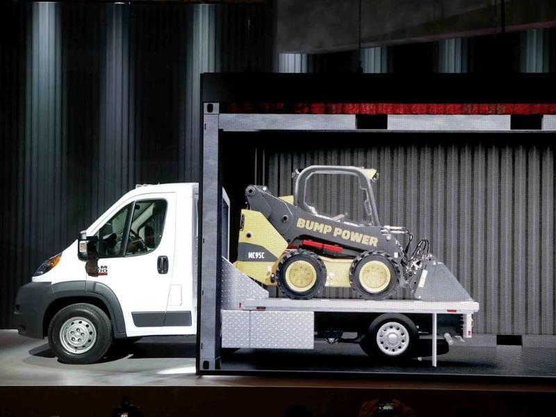 A projection screen shows one of the multiple chassis cab configurations that can be manufactured for the 2014 Ram ProMaster 3500 at the Chicago Auto Show in Chicago. (AP Photo)