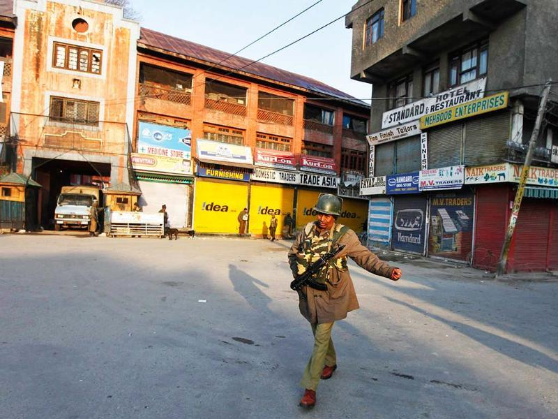 A policeman patrols a deserted road during restriction in Srinagar after Afzal Guru was hanged for plotting the 2001 Parliament attack. Reuters/Danish Ismail