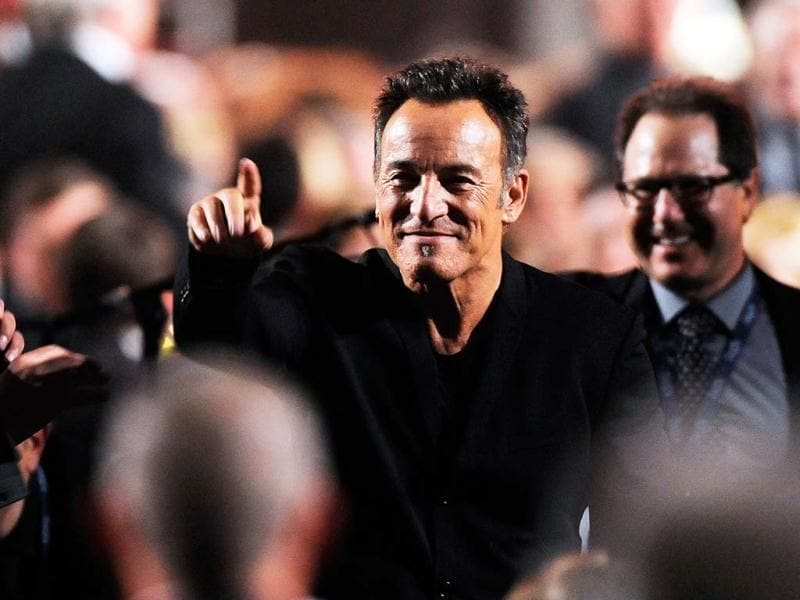 Honoree Bruce Springsteen gestures to attendees at the MusiCares Person of the Year tribute at the Los Angeles Convention Center in Los Angeles. AP