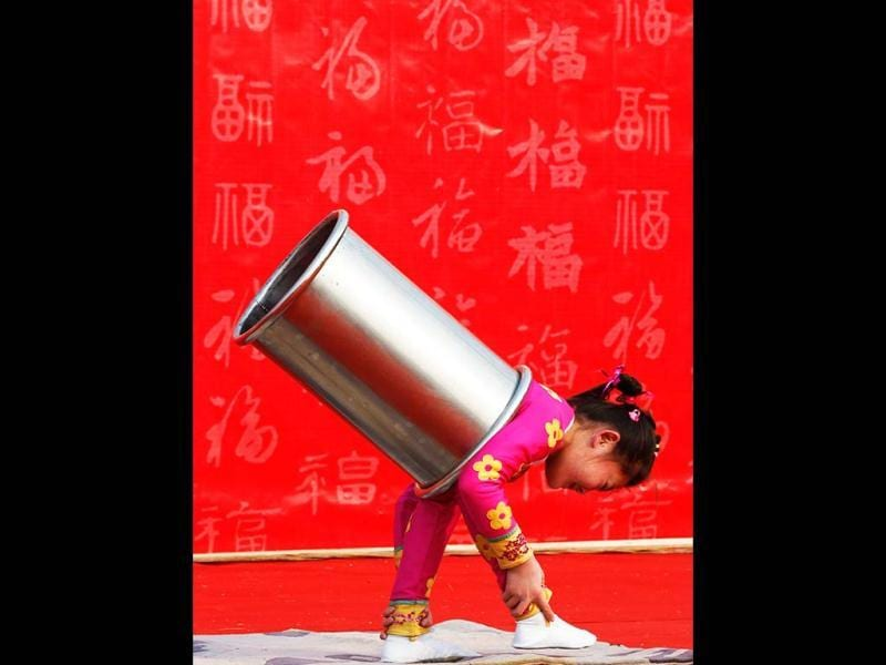 A girl performs an acrobatic show during the temple fair in Ditan Park, also known as the Temple of Earth, in Beijing. Reuters