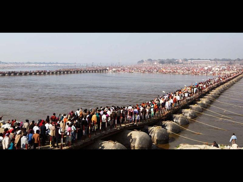 Thousands of devotees walk across a pontoon bridge at Sangam, before bathing at the confluence of the Rivers Ganges, Yamuna and Saraswati, during Maha Kumbh festival, in Allahabad. AP