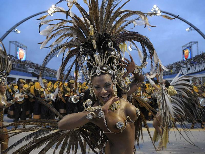 The main Carnival days in Sao Paulo are Friday and Saturday, when the area's top samba schools compete for bragging rights to being the best dancers in the city. The Sambadrome attracts 30,000 roaring spectators, while the streets open up into open-air parties. Photo: AFP/Mauricio Lima