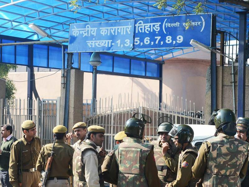 Police keep watch outside Tihar Jail, where Mohammed Afzal Guru was reportedly hanged, in New Delhi. AFP