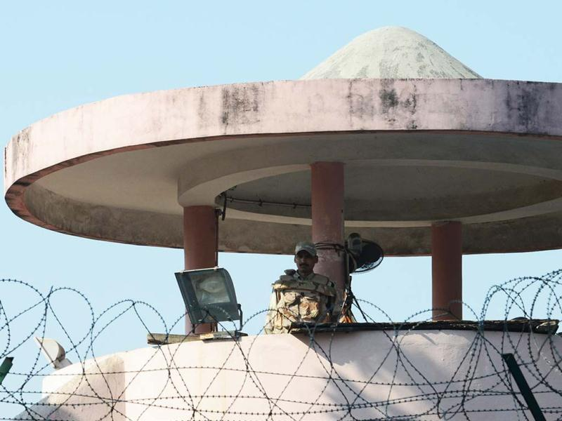 An policeman stands guard at a watchtower at Tihar Jail, where Mohammed Afzal Guru was reportedly hanged, in New Delhi. AFP