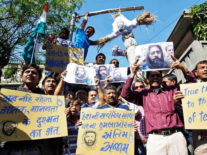 Demonstrators carry placards and posters and an effigy depicting Mohammad Afzal Guru during celebrations in Ahmedabad. Reuters