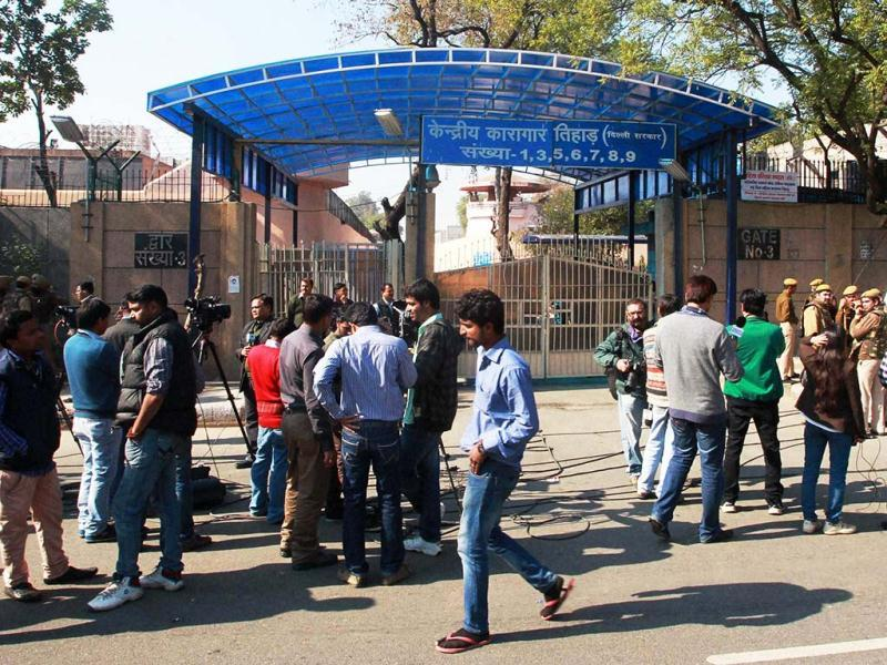 Media persons gather at the premises of Tihar jail where Afzal Guru, the Jaish-e-Mohammad militant convicted in attack on Parliament in 2001, was hanged, in New Delhi. PTI