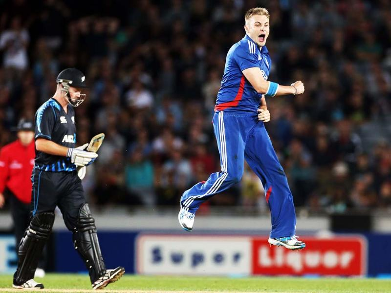 England's Luke Wright celebrates the wicket of New Zealand's Martin Guptill (not pictured) as New Zealand's Colin Munro looks on during the International Twenty20 cricket match between New Zealand and England played at Eden Park in Auckland. AFP/Michael Bradley