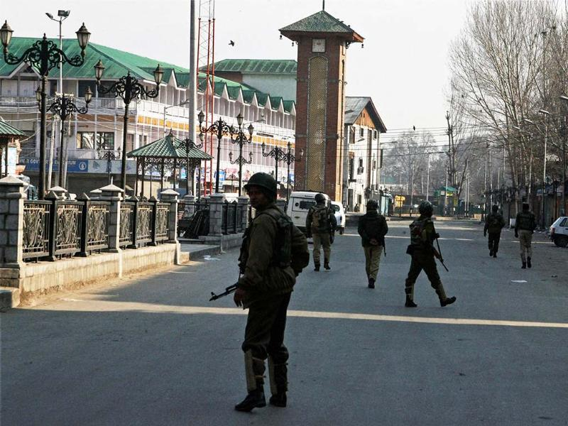 Paramilitary jawans patrolling a street during curfew in Srinagar. The curfew was imposed following the hanging of Parliament attack convict Afzal Guru. PTI/S Irfan