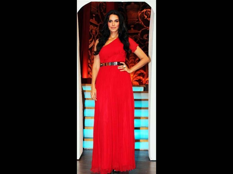 Neha Dhupia looks classy in a blood red one-shoulder gown.
