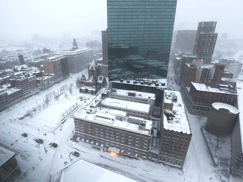 Snowplows (lower left) move past Copley Square during a blizzard in Boston, Massachusetts. AFP