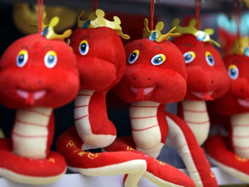 Snake toys are displayed for sale at a temple fair to celebrate the Chinese Lunar New Year at Ditan Park (the Temple of Earth), in Beijing. (Reuters)
