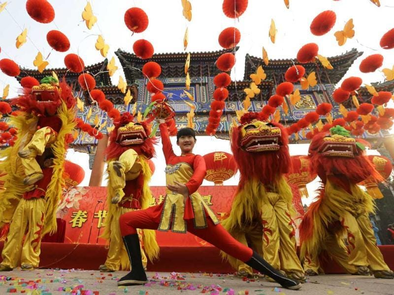 Chinese artists perform the lion dance during the opening ceremony of the Spring Festival Temple Fair at Ditan Park (the Temple of Earth), in Beijing. (Reuters)