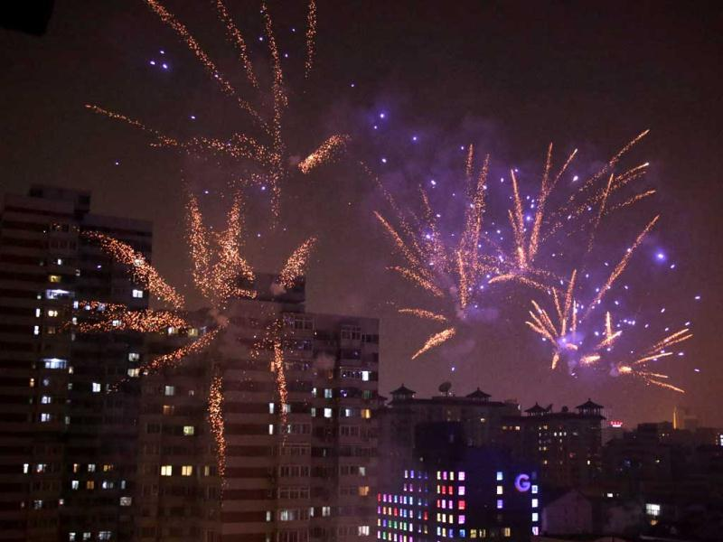 Fireworks light up the skyline of Beijing as residents celebrate the start of the Chinese New Year. (Reuters)