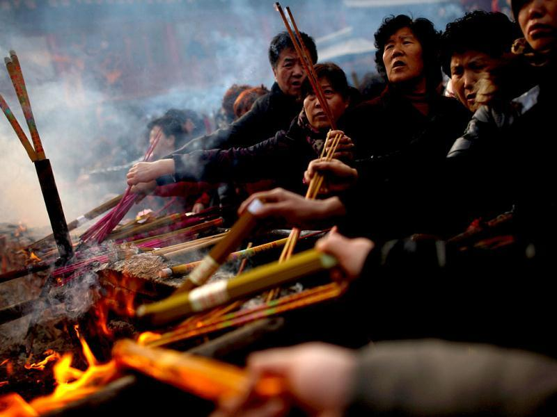 People burn incense to pray for good fortune on the first day of the Chinese Lunar New Year at Wuquanshan temple in Lanzhou. Reuters