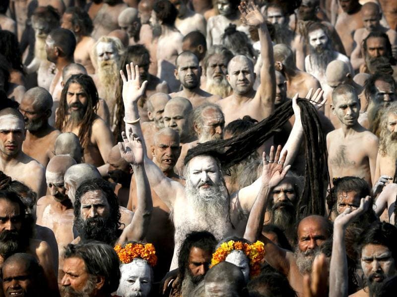 Holy men walk in procession after bathing at Sangam, the confluence of the Ganges, Yamuna and Saraswati River, during the Maha Kumbh Mela in Allahabad. AP