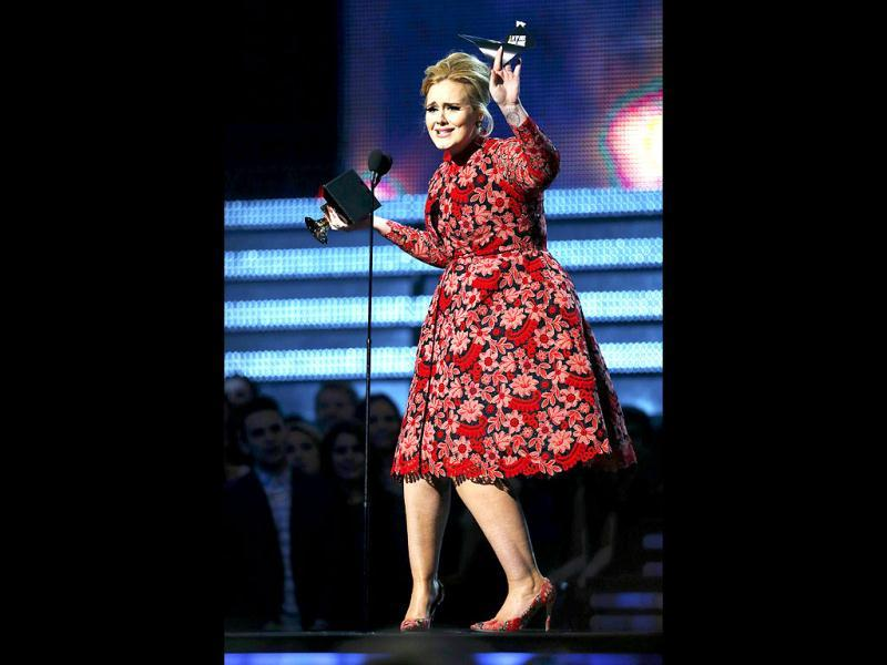 Adele receives the Grammy for best pop solo performance. (AFP Photo)