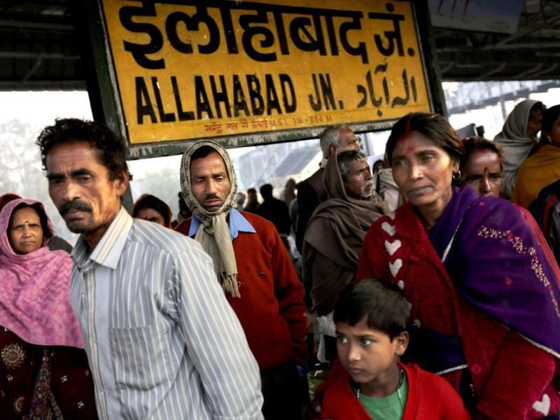 People wait on a platform to leave the main station in Allahabad. AP Photo