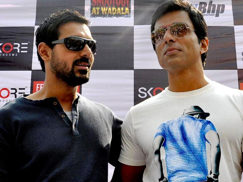 Film actors John Abraham (L) and Sonu Sood pose during the Super Bike Rally for the promotion of their upcoming film Shoot out at Wadala in Mumbai. (AFP PHOTO)