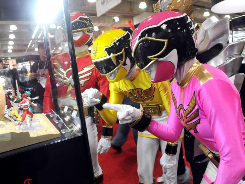 The Power Rangers check out their 20th anniversary collectibles at the American International Toy Fair in New York. AP/Diane Bondareff/Invision for Saban Brands
