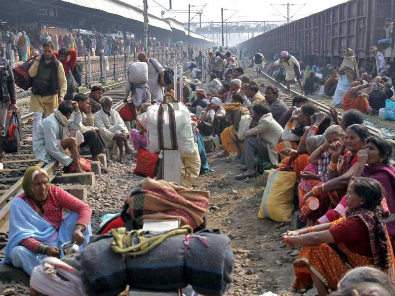 Pilgrims wait to board a train at an overcrowded railway station in Allahabad, the site of the fatal stampede. (Reuters)
