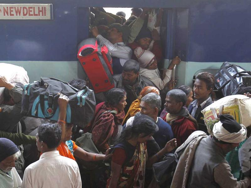 Pilgrims crowd to board a train at an overcrowded railway station in Allahabad, the site of the fatal stampede. (Reuters)