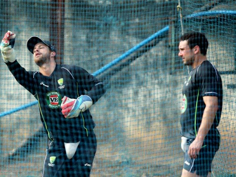 Australian cricketers Matthew Wade and Ed Cowan practice ahead of the first Test match against India in Chennai. PTI /R Senthil Kumar
