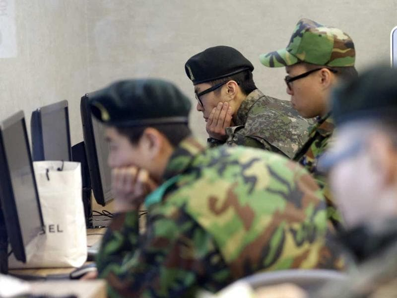 South Korean soldiers watch computer screens following a report about a possible nuclear test conducted by North Korea, at the Seoul train station in Seoul. AP Photo