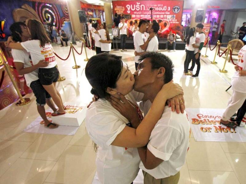 Participants Ekkachai Tiranarat, (centre R), 44, kisses Laksana Tiranarat, 33, during an attempt to break the world record for the longest kiss in Pattaya, 150 km (90 miles) east of Bangkok. Reuters