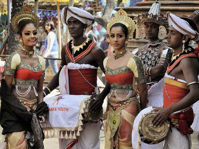 Artists from Sri Lanka perform during 27th International Art and Craft Mela 2013 at Surajkund. Photo: PTI