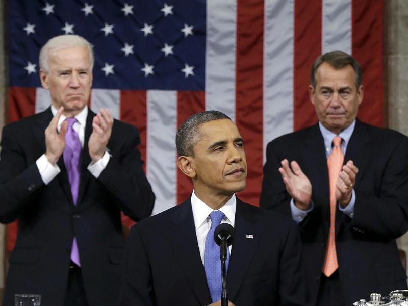 US House Speaker John Boehner (R-OH) and Vice President Joe Biden (L) stand to applaud as President Barack Obama delivers his State of the Union speech on Capitol Hill in Washington. Reuters