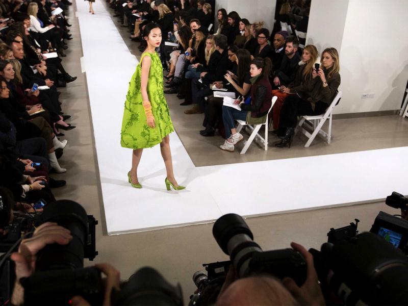 A model presents a creation from the Oscar De La Renta Autumn/Winter 2013 collection during New York Fashion Week 2013. Reuters