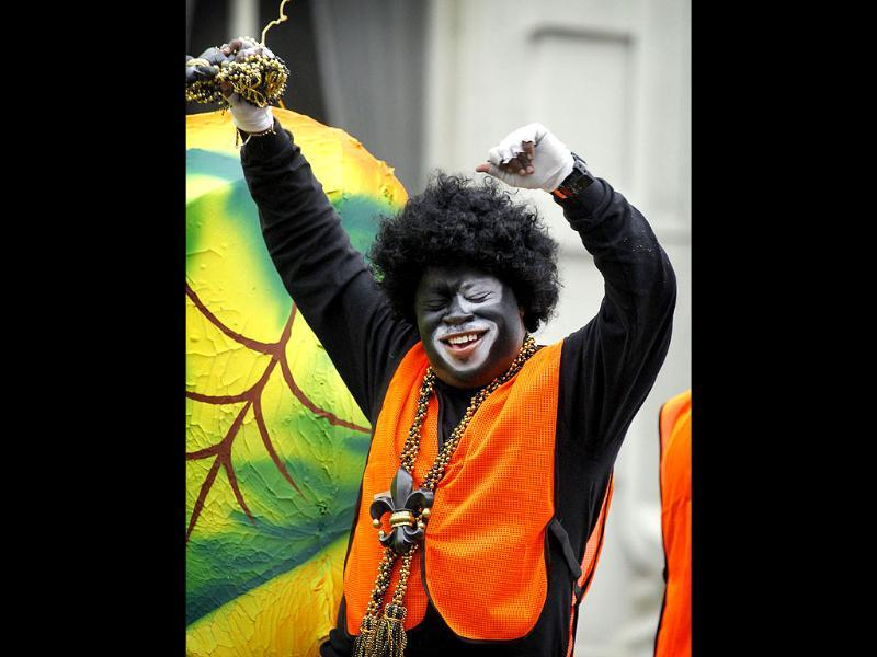 A rider in the Krewe of Zulu parade dances as his float rolls down Canal Street in New Orleans on Mardi Gras Day. AFP photo