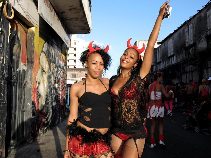 Revellers pose during a Mardi Gras carnival parade in Fort-de-France on the French Caribbean island of Martinique. AFP PHOTO