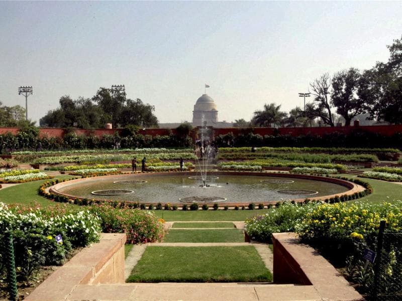 Flower beds around a fountain are seen at the Mughal Gardens. This year there will be special days for farmers, differently abled persons and defence and paramilitary personnel. PTI/Atul Yadav