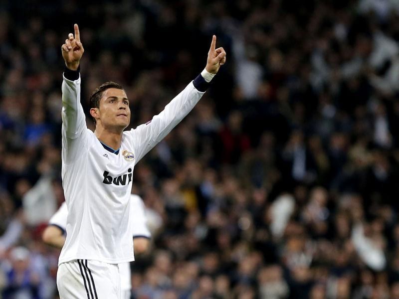 Real Madrid's Portuguese forward Cristiano Ronaldo celebrates after scoring during the UEFA Champions League match between Real Madrid and Manchester United at the Santiago Bernabeu stadium in Madrid. AFP
