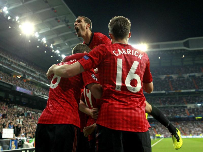 Manchester United's Rio Ferdinand celebrates with teammates after Danny Welbeck scored the opening goal during the Champions League match between Real Madrid and Manchester United at the Santiago Bernabeu stadium in Madrid. AP