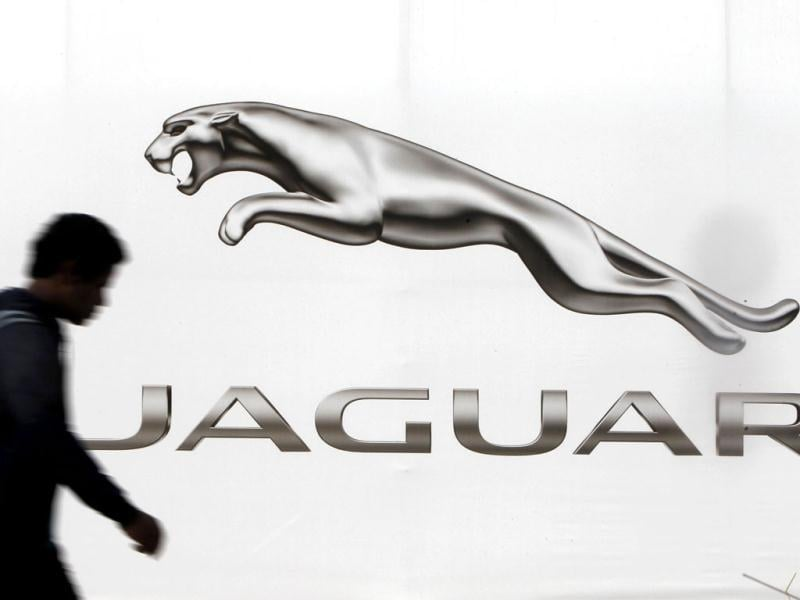 A man walks past a billboard advertising Jaguar in New Delhi. Hit by falling margins and rising capital expenditure, roaring Jaguar Land Rover (JLR) may be heading for a speed trap. (Reuters)