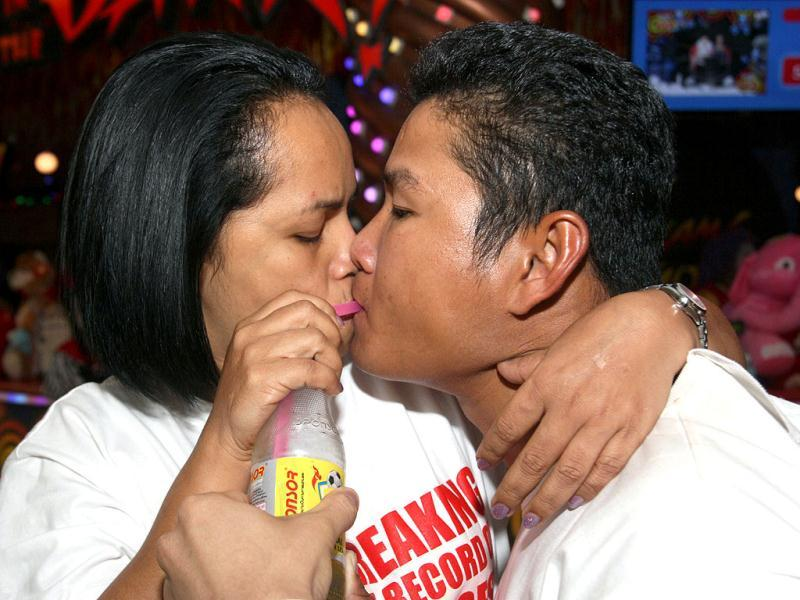 Sanom Raksa and Surasak Plaungklang sip an energy drink while competing in the World's Longest Continuous Kiss Competition in Pattaya, southeastern Thailand. AP Photo
