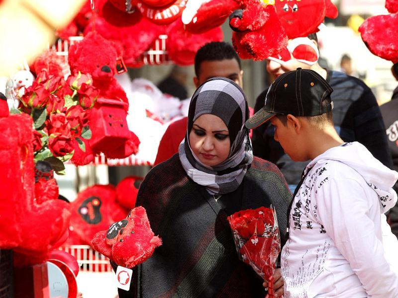 A woman carries a bouquet of flowers in a shop during Valentine's Day celebrations in Baghdad. Reuters Photo