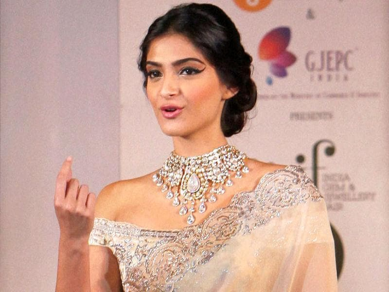 I'd like to say something please! Sonam Kapoor caught mid-sentence at the Gem and Jewellery Fair in New Delhi.