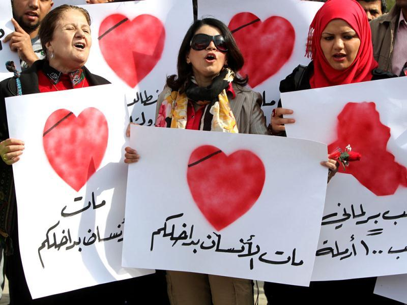 Iraqi women take part in Valentine's Day rally in Baghdad's Tahrir Square calling for better public services and for a corruption-free. AFP Photo