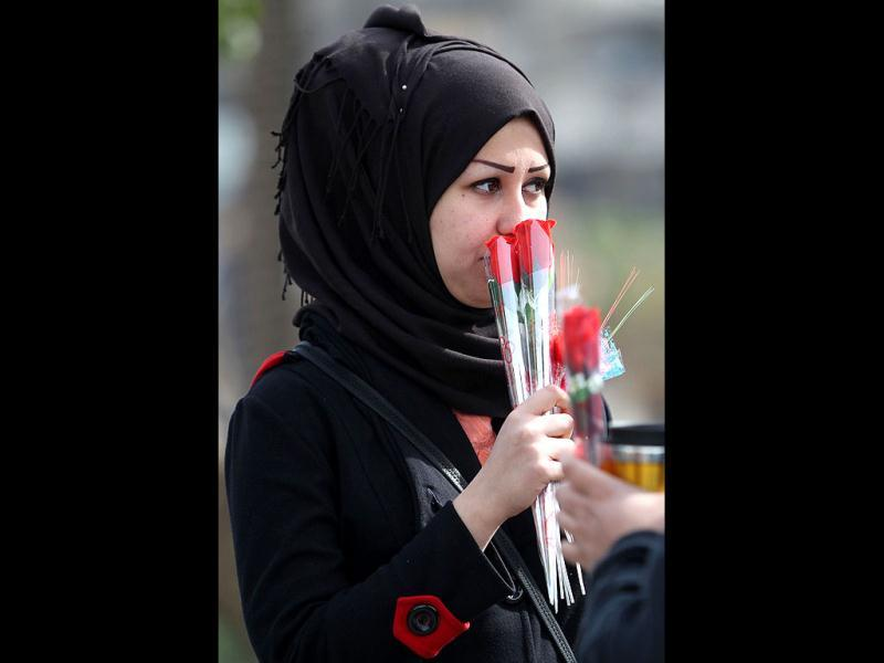An Iraqi woman holds roses during a Valentine's Day rally in Baghdad's Tahrir Square calling for better public services and for a corruption-free. AFP Photo