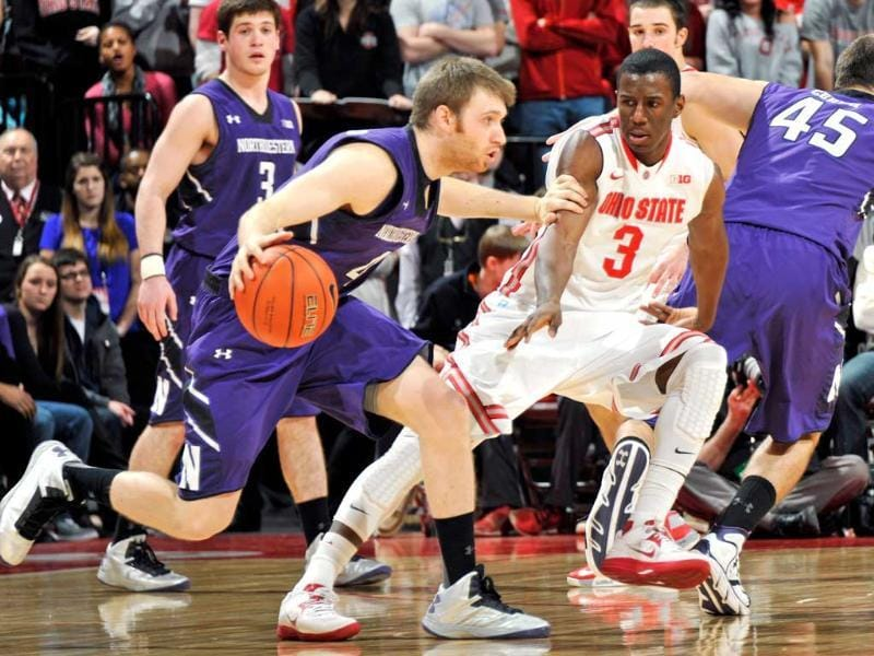 Shannon Scott #3 of the Ohio State Buckeyes guards Alex Marcotullio #4 of the Northwestern Wildcats in the second half at Value City Arena in Columbus, Ohio. AFP/Jamie Sabau/Getty Images