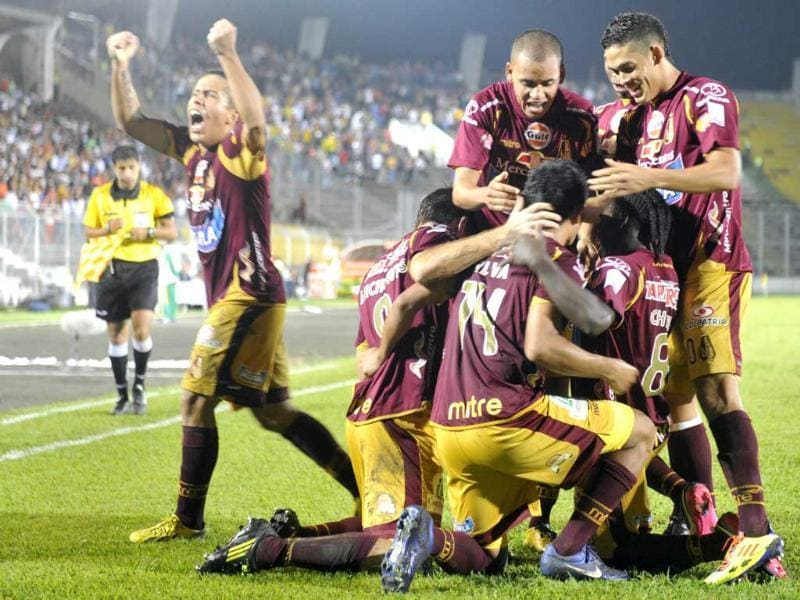 Colombia's Tolima player David Macalister Silva celebrates with teammates after scoring against Paraguay's Cerro Porteno during their Copa Libertadores 2013 football match at Manuel Murrillo Toro stadium in Ibague, Colombia. AFP/Eitan Abramovich