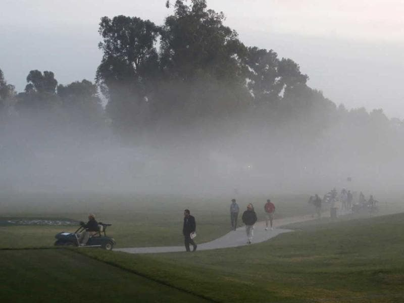 Fog and gathering darkness bring an end to the first round of the Northern Trust Open golf tournament before all players had finished, at Riviera Country Club in the Pacific Palisades area of Los Angeles. AP/Reed Saxon