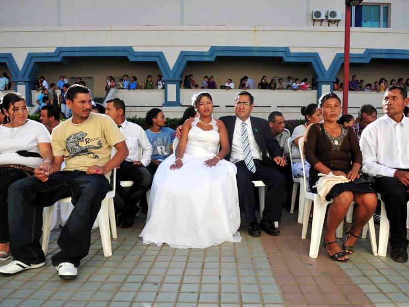 Couples take part in a mass civil wedding of 560 couples held in Managua. AFP/Hector Retamal