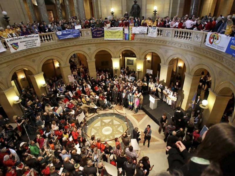 Hundreds gathered at the State in St. Paul, Minn., where supporters of gay marriage called for Minnesota lawmakers to legalise gay marriage. AP/Jim Mone
